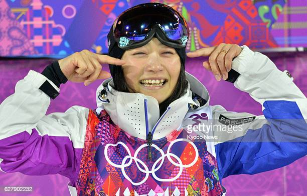 SOCHI Russia Japan's Aiko Uemura gestures to her supporters for her 'tears of gratitude' after finishing her third and last run in the Winter...