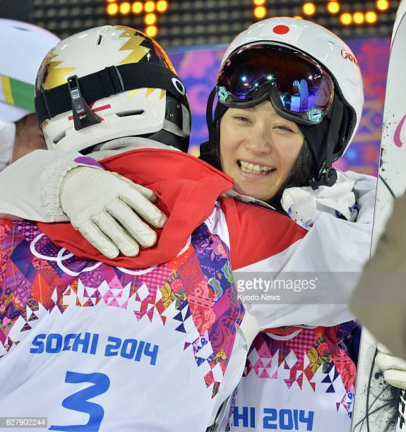 SOCHI Russia Japan's Aiko Uemura gives Canada's Chloe DufourLapointe a hug after the latter finished her third run in the Winter Olympics women's...
