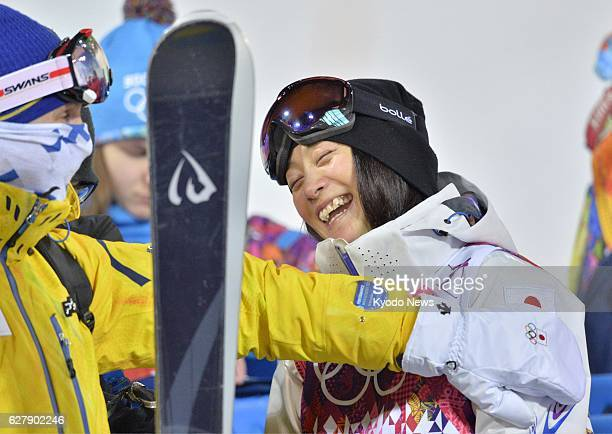 SOCHI Russia Japan's Aiko Uemura receives encouragement from her supporters after finishing fourth in the Winter Olympics women's moguls final at the...