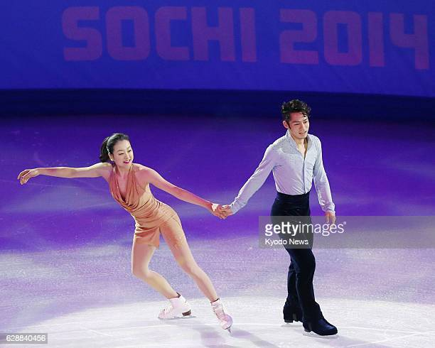 SOCHI Russia Japan's Mao Asada and Daisuke Takahashi skate holding hands during a figure skating exhibition at the Winter Olympics in Sochi Russia on...