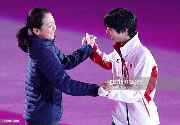 SOCHI Russia Japan's Mao Asada and Yuzuru Hanyu hold hands during rehearsal for a Winter Olympics figure skating gala exhibition at the Iceberg...