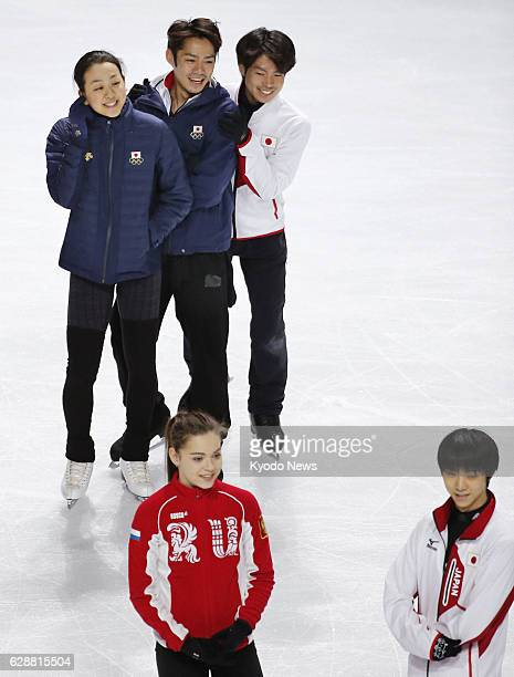 SOCHI Russia Japan's Mao Asada Daisuke Takahashi and Tatsuki Machida are pictured together during practice for a figure skating exhibition of the...