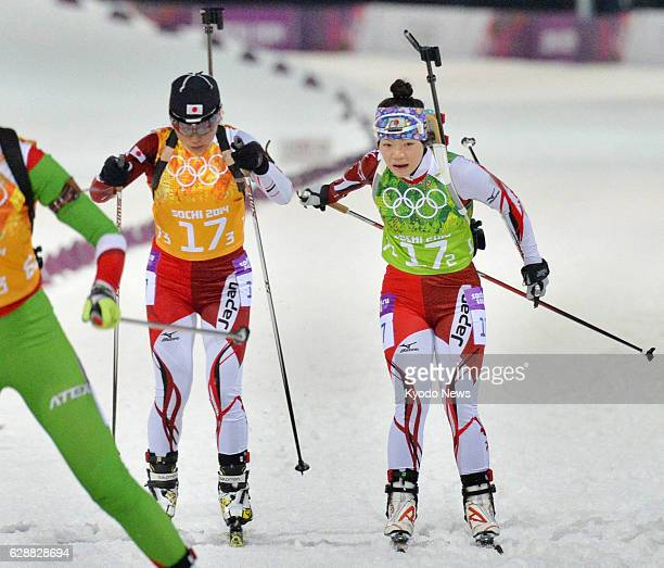 SOCHI Russia Japan's second runner Yuki Nakajima tags third runner Miki Kobayashi in the women's biathlon 4x6kilometer relay at the Laura...