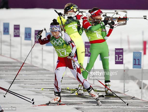 SOCHI Russia Japan's Yuki Nakajima starts her sprint after shooting her rifle in the women's biathlon 4x6kilometer relay at the Laura Crosscountry...