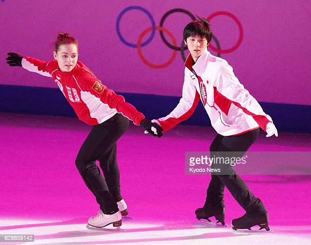 SOCHI Russia Japan's Yuzuru Hanyu and Russia's Adelina Sotnikova the Sochi Olympics gold medalists for men's and women's figure skating respectively...