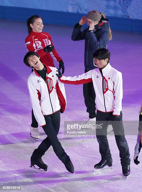 SOCHI Russia Japan's Yuzuru Hanyu smiles after his offer to pair up is rejected by his compatriot Tatsuki Machida during practice for a figure...