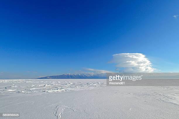Russia, Lake Baikal, sunny day above frozen lake