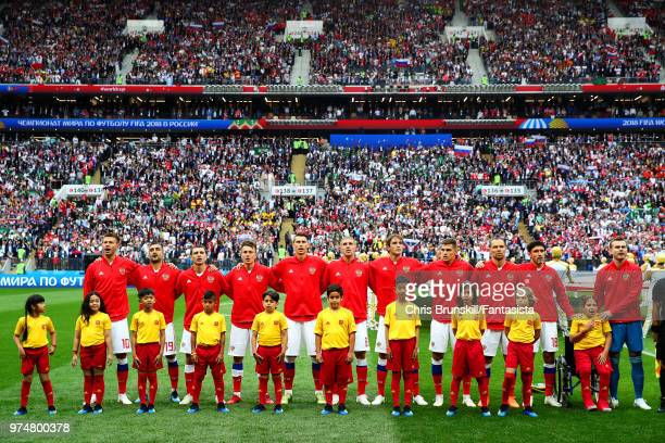 Russia line up for the national anthem ahead of the 2018 FIFA World Cup Russia group A match between Russia and Saudi Arabia at Luzhniki Stadium on...