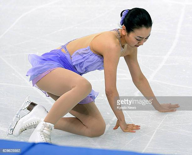 SOCHI Russia Mao Asada of Japan falls as she attempts to land her triple axel in the women's short program of the figure skating competition at the...