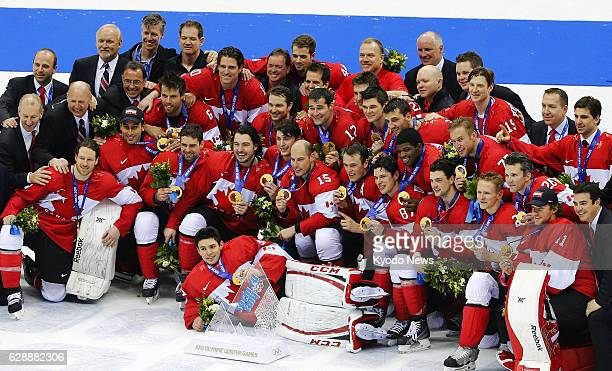 SOCHI Russia Members of the Canadian ice hockey team pose for photos with their gold medals after defeating Sweden 30 in the men's final at the...