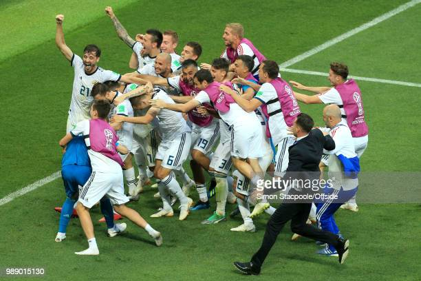 Russia mob Russia goalkeeper Igor Akinfeev after he saves the final penalty and wins them the match during the 2018 FIFA World Cup Russia Round of 16...