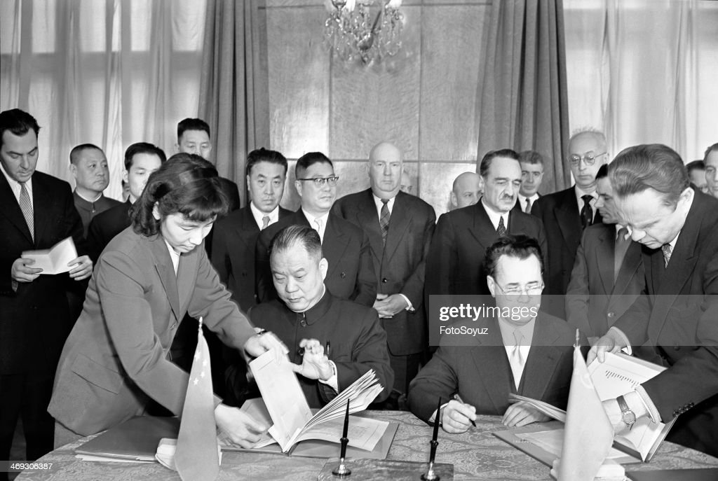 Signing of the State agreement about commodity circulation of the USSR and the Peoples Republic of China. : News Photo
