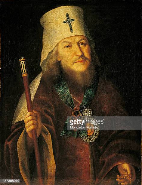 Russia Moscow Gosudarstvennyj Istoriceskij Muzej All The man with beard wears a red tunic with decorations a headdress with a cross a necklace and an...