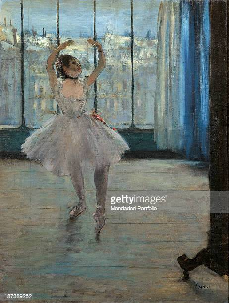 Russia Moscow Pushkin Museum of Fine Arts All A ballet dancer poses with raised arms in a photographic studio