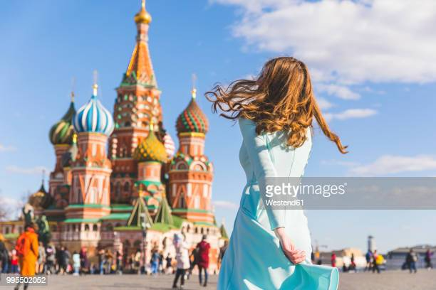 russia, moscow, red square, teenage girl rotating - moscow russia stock pictures, royalty-free photos & images