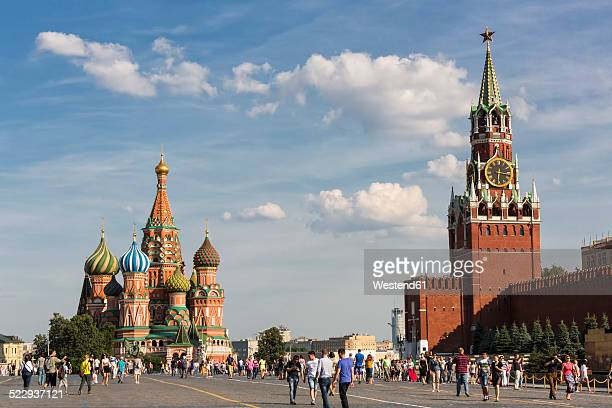 russia, moscow, saint basil's cathedral with kremlin wall and spasskaya tower - moscow russia stock pictures, royalty-free photos & images