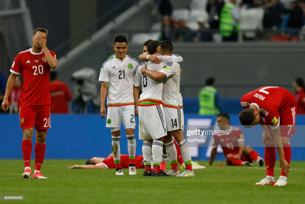 Russia national team players Maksim Kanunnikov (L), Alexander Samedov (2nd R) and Dmitry Poloz (R) react as Mexico national team players Luis Reyes (N21), Javier Hernandez (N14) and Jonathan Dos Santos celebrate victory during the Group A - FIFA Confederations Cup Russia 2017 match between Russia and Mexico at Kazan Arena on June 24, 2017 in Kazan, Russia.