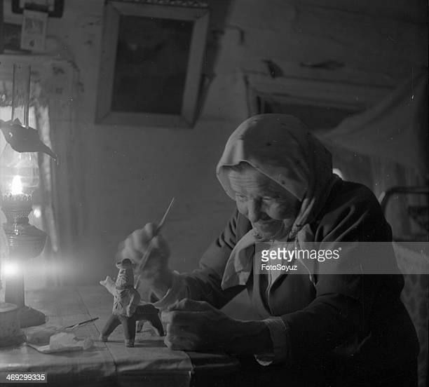 Russia NorthWest Arkhangelsk Region 1960s The ninetyyear oldest on Kargopolshchine the hereditary skilled worker kargopolskih painted clay toys...