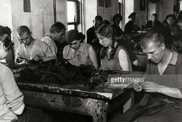 Circa 1920's, Male and female convicts working together in Taganka jail Moscow