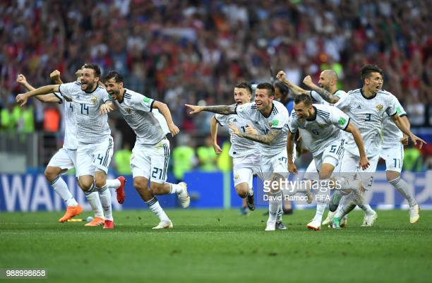 Russia players celebrate following their sides victory in a penalty shoot out during the 2018 FIFA World Cup Russia Round of 16 match between Spain...