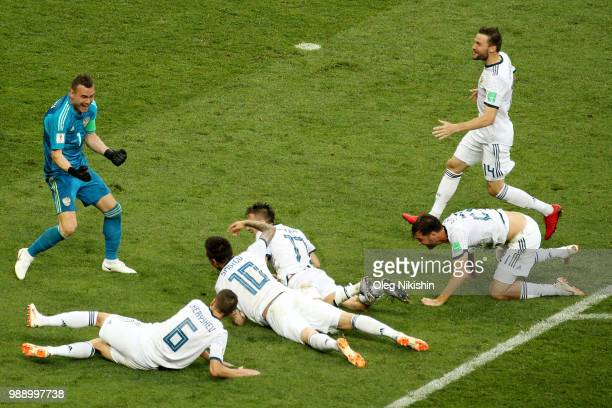Russia players celebrate following their sides victory in the penalty shoot out during the 2018 FIFA World Cup Russia Round of 16 match between Spain...
