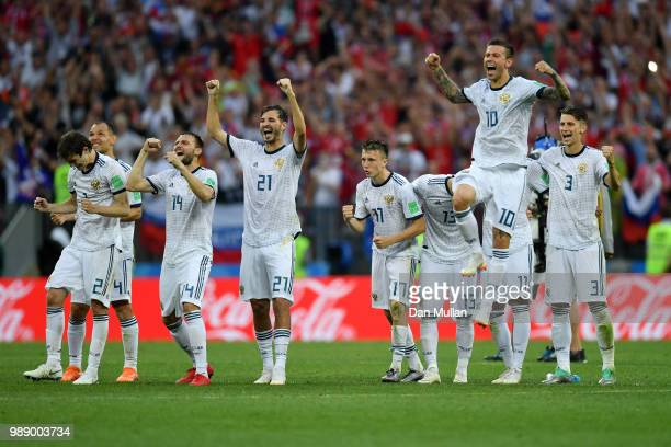 Russia players celebrate their victory following the 2018 FIFA World Cup Russia Round of 16 match between Spain and Russia at Luzhniki Stadium on...