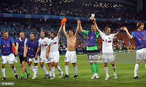 Russia players celebrate victory after the UEFA EURO 2008 Quarter Final match between Netherlands and Russia at St JakobPark on June 21 2008 in Basel...