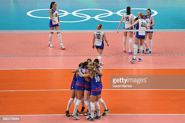 Russia players celebrate winning a point during the Women's Quarterfinal match between Russia and Serbia on day 11 of the Rio 2106 Olympic Games at...