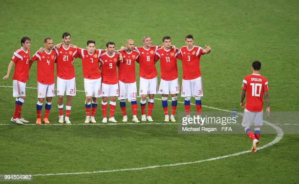 Russia players encourage Fedor Smolov after the missed penalty part of the penalty shoot out during the 2018 FIFA World Cup Russia Quarter Final...