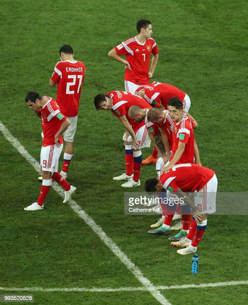 Russia players look dejected following their defeat in the penalty shoot out during the 2018 FIFA World Cup Russia Quarter Final match between Russia...
