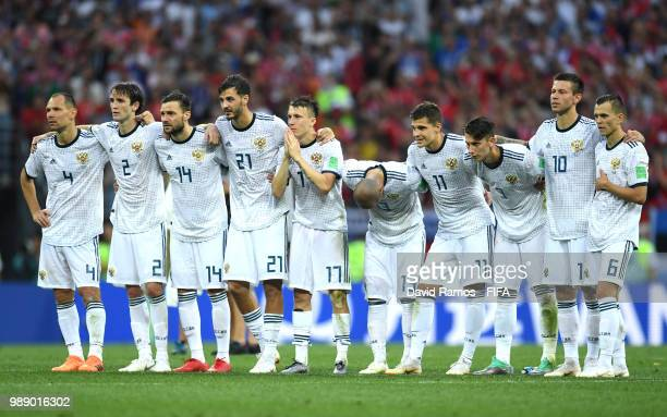 Russia players look on during the penalty shoot out following the 2018 FIFA World Cup Russia Round of 16 match between Spain and Russia at Luzhniki...