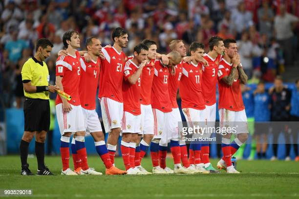 Russia players watch the penalty shoot out during the 2018 FIFA World Cup Russia Quarter Final match between Russia and Croatia at Fisht Stadium on...