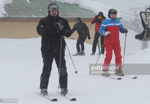 Russia President Vladimir Putin and Belarus President Alexander Lukashenko go skiing after their meeting in Sochi on February 22, 2021.