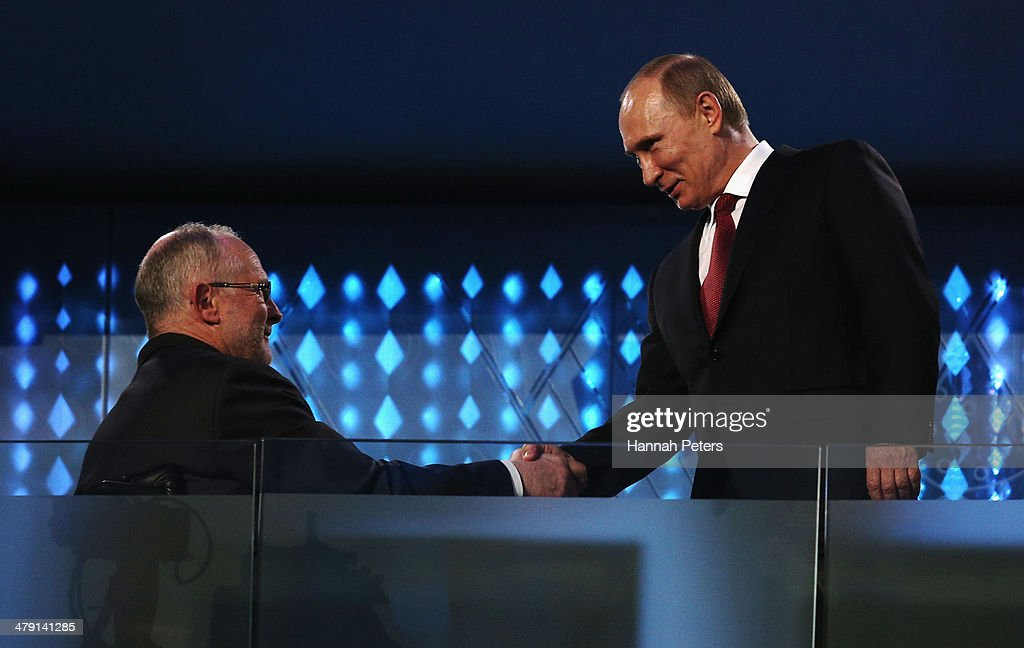 Russia President Vladimir Putin (R) shakes hands with International Paralympic Committee (IPC) President Sir Philip Craven during the Sochi 2014 Paralympic Winter Games Closing Ceremony at Fisht Olympic Stadium on March 16, 2014 in Sochi, Russia.