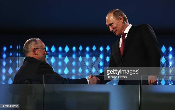Russia President Vladimir Putin shakes hands with International Paralympic Committee President Sir Philip Craven during the Sochi 2014 Paralympic...