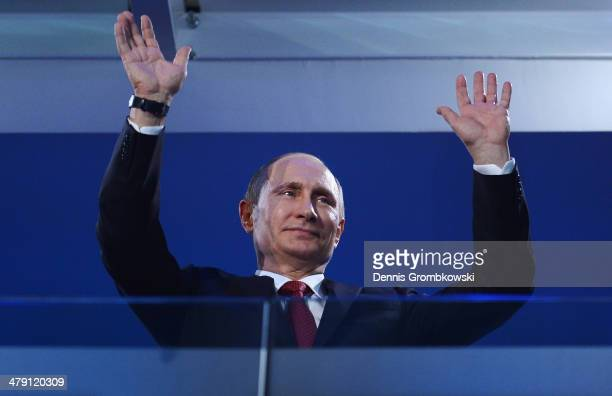 Russia President Vladimir Putin waves during the Sochi 2014 Paralympic Winter Games Closing Ceremony at Fisht Olympic Stadium on March 16 2014 in...