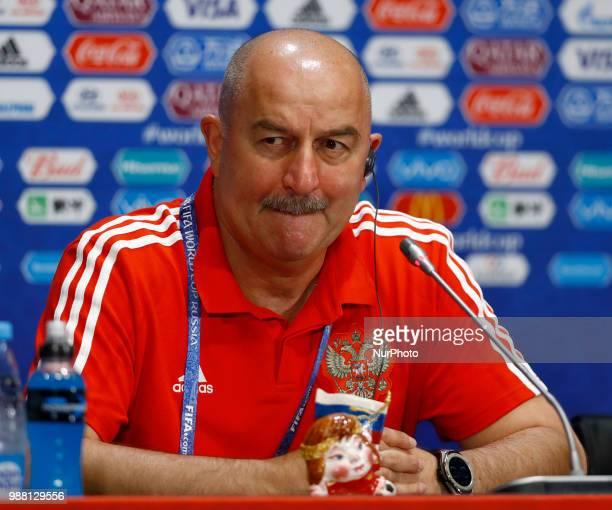 Russia press conference FIFA World Cup Russia 2018 Russia coach Stanislav Cherchesov with a russian journalist gift at Luzhniki Stadium in Moscow...