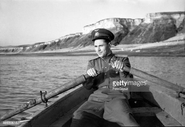 Russia Privolzhski okrug Saratov Region 1940s Hero of the Soviet Union major Skosherkov in a boat Autumn 1945