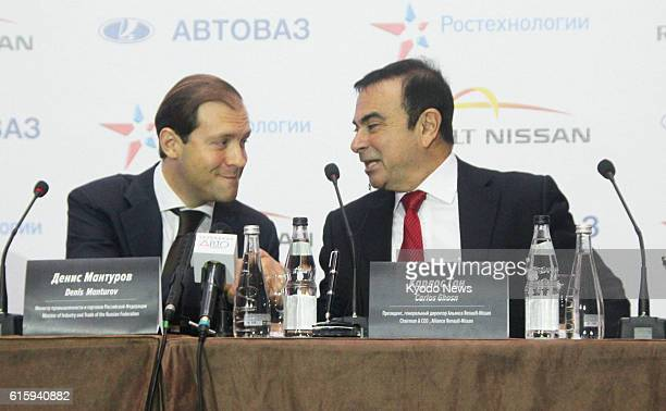 MOSCOW Russia Russian Industry and Trade Minister Denis Manrurov and Nissan Motor Co President Carlos Ghosn chat during a signing ceremony in Moscow...
