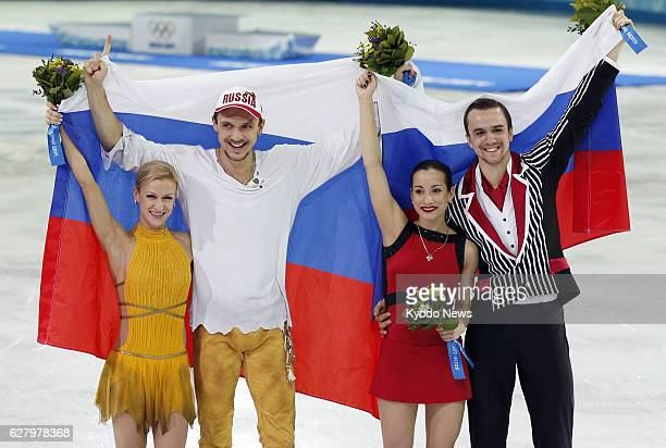 SOCHI Russia Russia's Tatiana Volosozhar and Maxim Trankov celebrate with compatriots Ksenia Stolbova and Fedor Klimov after winning the Winter...