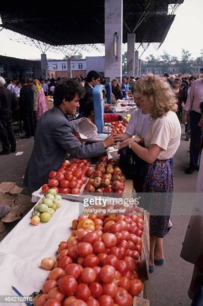 Russia Siberia Irkutsk Market Scene Man Selling Tomatoes And Apples