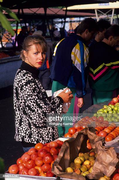 Russia Siberia Novosibirsk Market Scene With Young Woman Buying Tomatoes