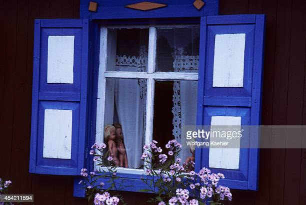 Russia Siberia Village Near Novisibirsk Colorful Window Of A Typical Wooden House In The Taiga Dolls In Window