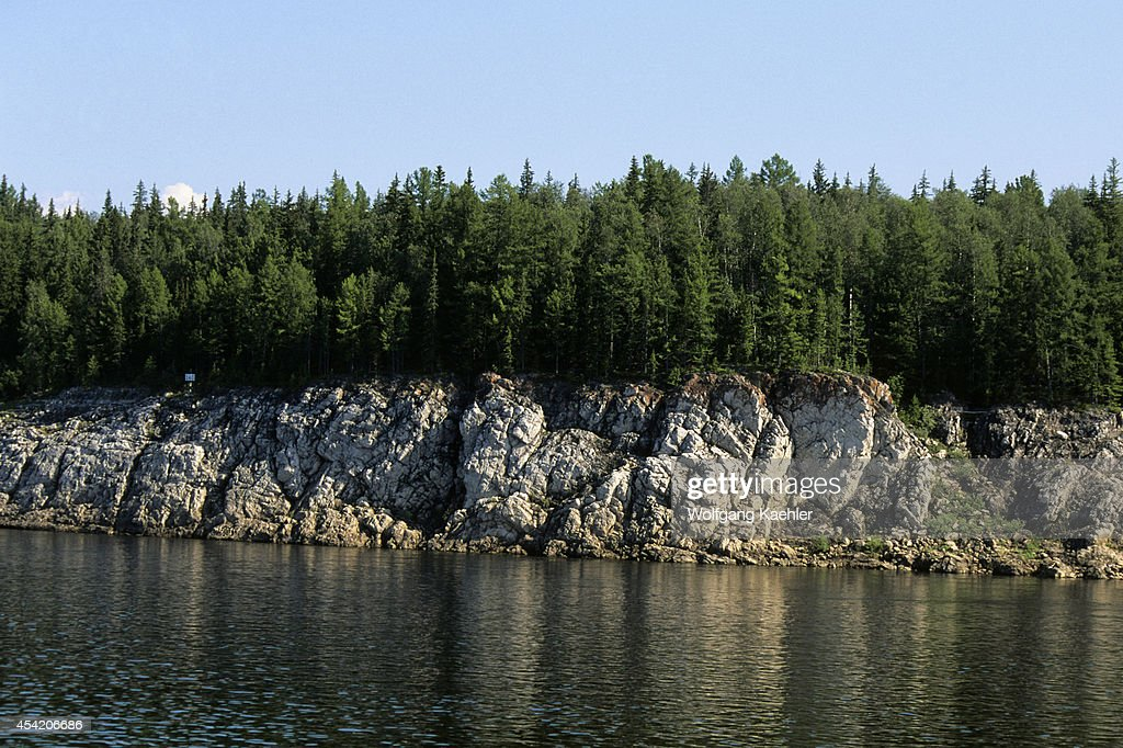 Russia, Siberia, Yenisey River, Near Turuchansk, Rocky Shore With Forest.