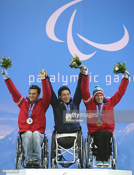 SOCHI Russia Silver medalist Philipp Bonadimann of Austria gold medalist Takeshi Suzuki of Japan and bronze medalist Roman Rabl of Austria celebrate...