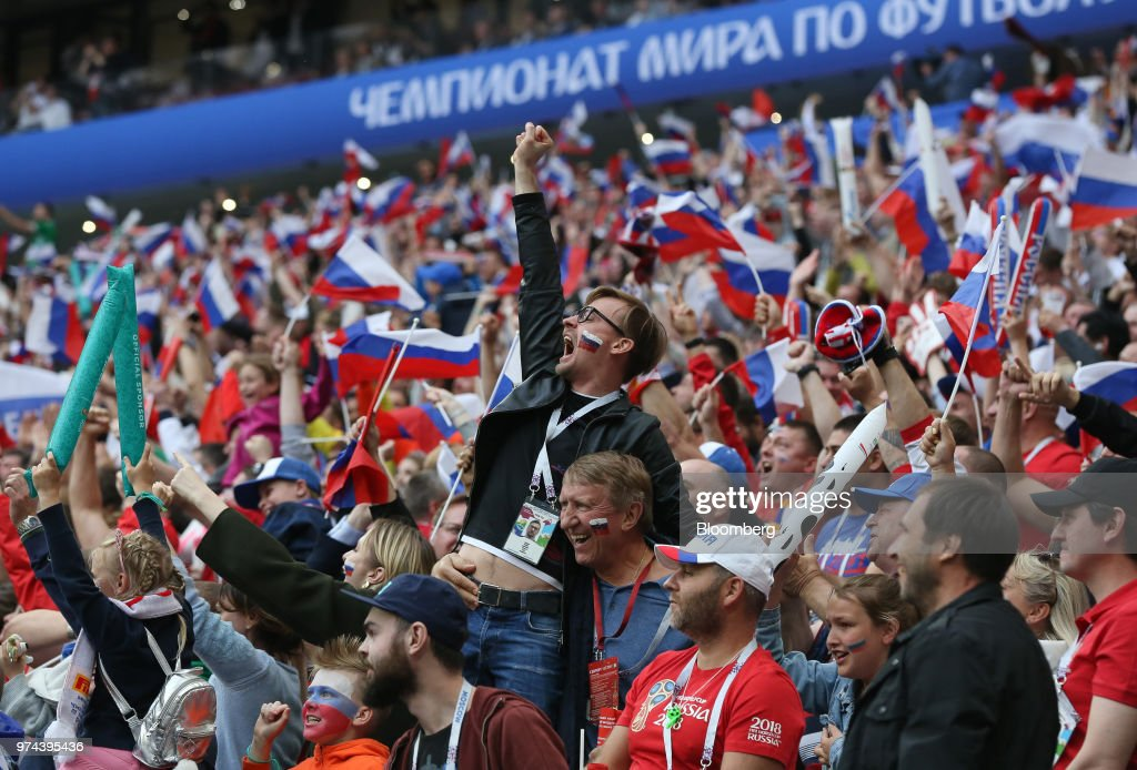 Russia soccer fans celebrate during the opening match of the FIFA World Cup between Russia and Saudi Arabia at the Luzhniki stadium in Moscow, Russia, on Thursday, June 14, 2018. President Vladimir Putin has spent six years and more than $11 billion preparing nearly a dozen Russian cities to host the soccer World Cup, the biggest such event the countrys held since the collapse of the Soviet Union. Photographer: Andrey Rudakov/Bloomberg via Getty Images