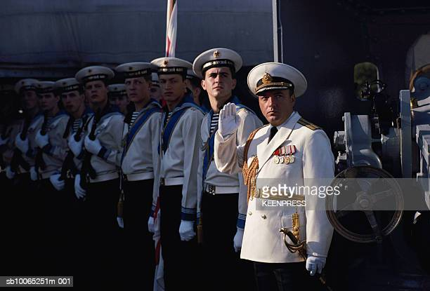 Russia St Petersburg Navy officers standing in row on deck of naval ship during Navy week looking to side 19890701
