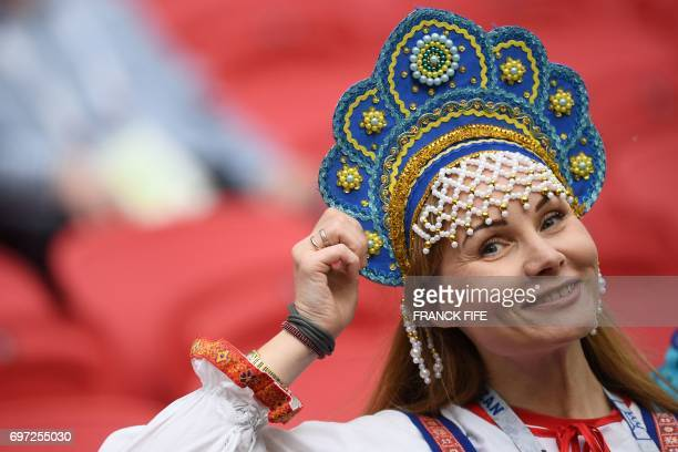 Russia supporter poses ahead of the 2017 Confederations Cup group A football match between Portugal and Mexico at the Kazan Arena in Kazan on June 18...