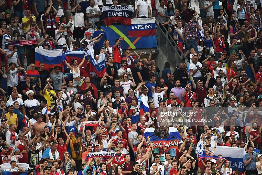 Russia supporters celebrate their team's late equaliser during the Euro 2016 group B football match between England and Russia at the Stade Velodrome in Marseille on June 11, 2016. / AFP / ANNE