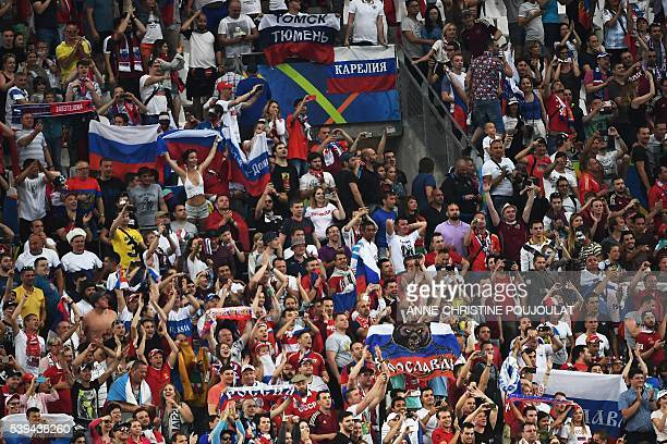 Russia supporters celebrate their team's late equaliser during the Euro 2016 group B football match between England and Russia at the Stade Velodrome...